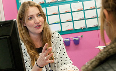 photo of carer advice team helping a student