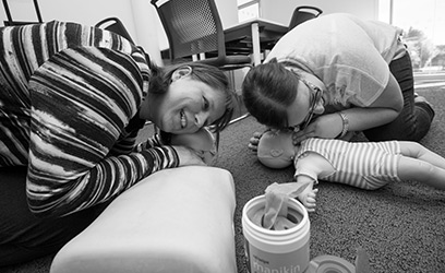 photo of two female students learning first aid on a infant dummy