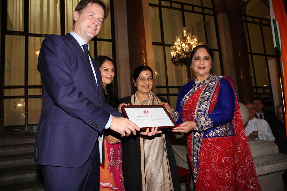 Presenting the Dadabhai Naoroji Award to Dame Asha (right) are (from left) Deputy Prime Minister Nick Clegg, UK Indian Diaspora Champion Priti Patel MP and India's External Affairs Minister Sushma Swaraj