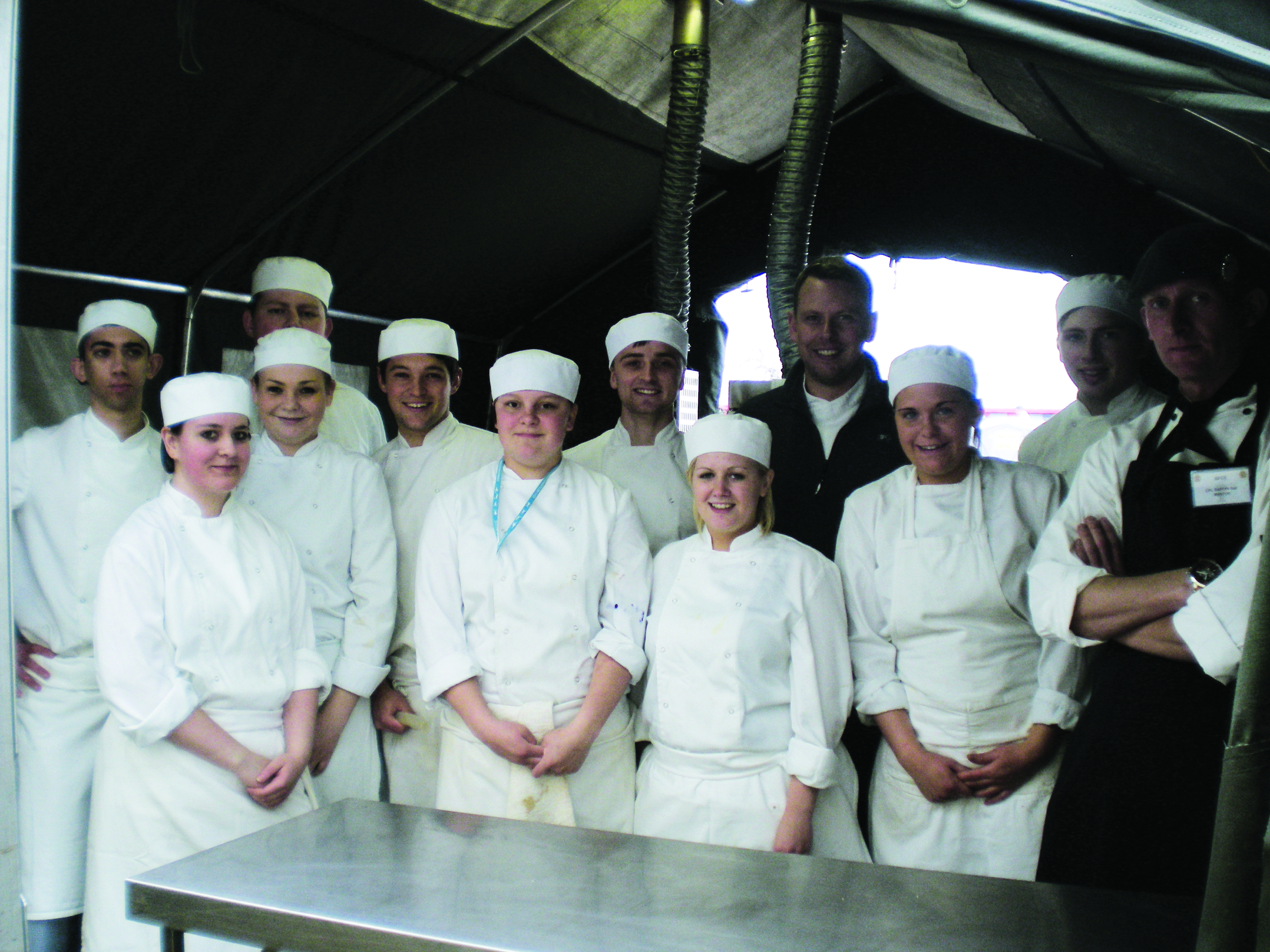 Student chefs in the field kitchen