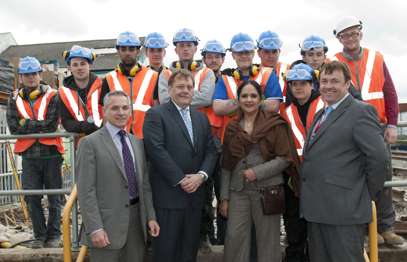 Mr Hayes (second left) with (L-R) Pino De Rosa, Asha Khemka and Wayne Chawner and rail apprentices