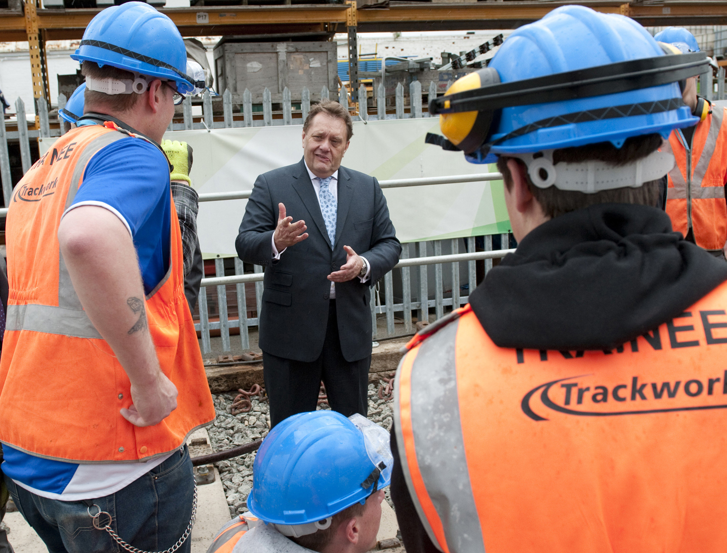 Mr Hayes in discussion with rail apprentices